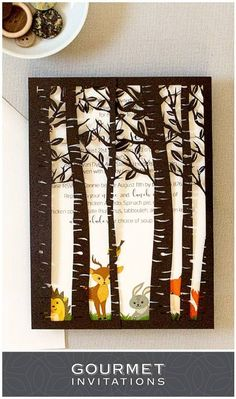 Adorable woodland baby shower invitations with a laser cut forest. PIN for later and be sure to click through to see all of the details.