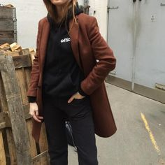 Or, wear it under a classic wool coat. Simple, but sharp; the definition of athluxury. #refinery29 http://www.refinery29.com/winter-layering-street-style-trend-photos#slide-6