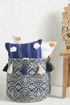 Perfect for storing blankets and linens, this handcrafted basket features a globally inspired design and a row of tassels for a textured, eclectic feel. Room Inspiration, Design Inspiration, Anthropologie, Storing Blankets, Decorative Storage, Decorative Accents, Affordable Furniture, Hanging Baskets, Storage Baskets