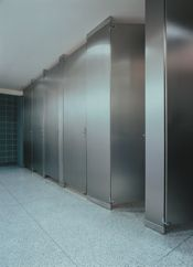Floor to Ceiling Toilet Partitions:  characterized by pilasters: vertical supports that stretch from floor to ceiling between each stall door. This style is considered to be the strongest of all types of partitions. Ceiling heights and material choice (plastic or stainless steel for example) will have an impact on that strength, with lower ceilings producing stronger partitions. Finally, floor to ceiling partitions provide extra coverage, resulting in more privacy for users.