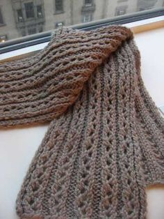Chunky, in a lace rib pattern that is beautifully reversible. Use size 10 needles...27 stitches (a multiple of 5 plus 2). It's a 4-row pattern that goes like this: Rows 1 and 3: K2, *p3, k2; repeat from *. Row 2: P2, *K1, yo, ssk, p2; repeat from *. Row 4: P2, *K2tog, yo, k1, p2; repeat from *.