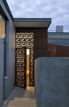 modern glass doors, overlay of perforated sheet of Corten steel, concrete home, contemporary desert design by Steven Holl Architects Wood House Design, Door Design, Exterior Design, Interior And Exterior, Architecture Details, Interior Architecture, Skylight Design, Steven Holl, Types Of Doors