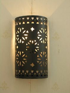 Wrought iron wall lights recreate the rustic relaxed feel of a Moroccan Atlas Mountain retreat.  Recreate this look with wall lights from Maroque http://www.maroque.co.uk/catalog.aspx?p=00090