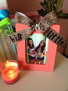 Wooden frame, strip of ribbon. Paint any color you want, make a bow, use a little rhinestone in the middle, write on with sharpie or puffy paint