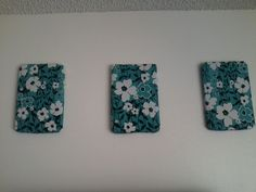 wall art made from water cases (cardboard bottom), hot glue and fabric.