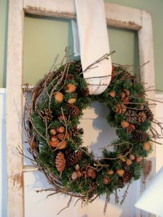 """plain """"evergreen wreath"""" on top of a grapevine wreath, add twigs and naturals...pretty!"""