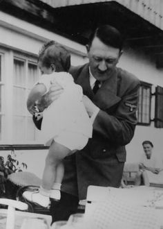"Adolf Hitler and Uschi Schneider at the Berghof. Eva Braun captioned these photos: ""Uschi really wants to get out of the chair."