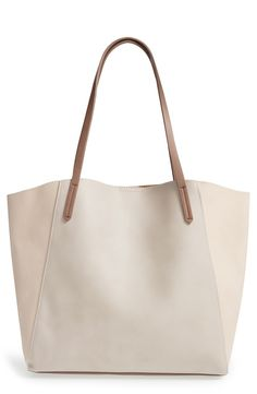 Loving this neutral tote that is perfect for storing the essentials while on the go.