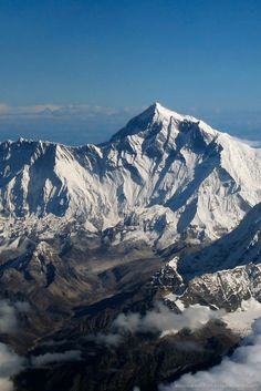 Mount Everest  -   World's tallest mountain at a little over 29,000 feet above sea-level & continuing to grow  -  located in the Himalaya Mountains  -  the summit marks the borders of Nepal, Tibet, and China  -  (this pic taken from China)