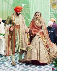 Beautiful Indian bride in grey maroon Rimple Harpreet Wedding Lehenga. There are different rumors about the real history of … Wedding Lehnga, Bridal Lehenga Choli, Sikh Wedding, Punjabi Wedding, Wedding Couples, Farm Wedding, Boho Wedding, Wedding Reception, Latest Bridal Lehenga