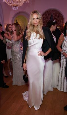 We love how Natasha Poly added structured to her elegant white one-shouldered dress with a black tuxedo blazer.