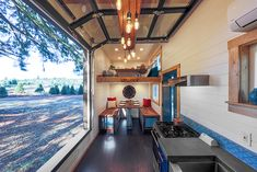 This is one couple's Rock Climbing Tiny House on Wheels! It was built by Tiny Heirloom. Actually, according to Inhabitat, this tiny house is called the Tiny Adventure The Mississippi c… Tiny House Swoon, Modern Tiny House, Tiny House On Wheels, Tiny House Design, Tiny Living, Living Spaces, Living Area, Rv Living, Living Room