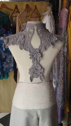 Close-up of crochet detail designer, Pablo Cabahug,used in place of a traditional Panuelo, a scarf-like garment that is worn to cover the arms and back...Gorgeous!