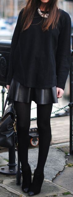 Black leather skater skirt, black opaque tights black heels--top could be almost anything