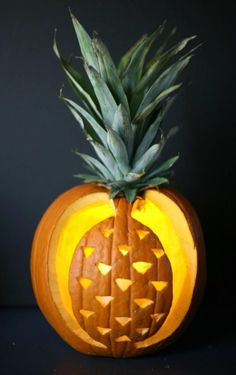 Pineapples aren't just for summer! This pineapple pumpkin carving idea is so much fun for the Fall and Halloween.