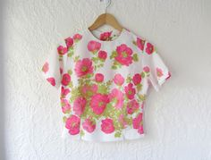 Pink floral blouse // 60s button back blouse // spring fashion. via Etsy.