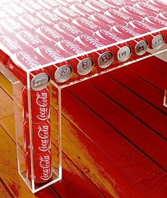 Table Made From Coca-Cola Cans. It would stay empty at my house lol (Coke Bottle Table) Coca Cola Decor, Coca Cola Can, Always Coca Cola, Coca Cola Bottles, Coke Cans, Pepsi Cola, Coca Cola Merchandise, Coca Cola Kitchen, Cocoa Cola