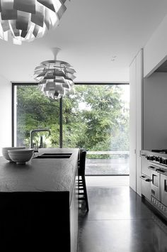 Beautiful kitchen with Louis Poulsen 'Artichoke' Design by Poul Henningsen lights | Daskal-Laperre