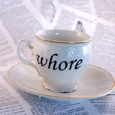 Anyone want a cuppa?  Whore Czech Republic Altered Vintage Teacup and by geekdetails, $35.00