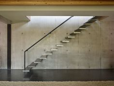 Stairs, Exposed Concrete Wall, West Seattle Residence with Spectacular Inlet Views Cantilever Stairs, Concrete Staircase, Concrete Steps, Modern Staircase, Concrete Wall, Staircase Ideas, Glass Stairs Design, Seattle Homes, West Seattle