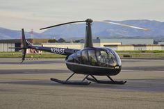 2009 Robinson R44 II N219ST c/n 12537 on the ramp at Livermore Airport in California 2018.