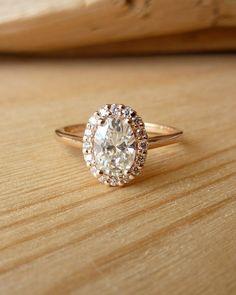 Oval Moissanite and Diamond Halo by kateszabone on Etsy, $2145.00---but diamond and white gold please :)