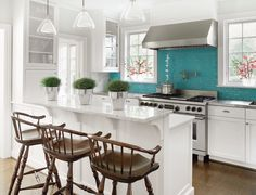 Turquoise glass tiles add a pop of color to the backsplash | Phoebe Howard