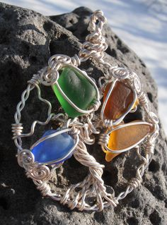 Beautiful colorful Tree of Life pendant made out of silver plated jewellery wire and 4 pieces of sea glass. Price is 25$ (+4$ S/H if mailed). To find more of my work, please visit Petra Designs facebook page.