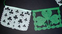 papel picado w/shamrock cut-outs for Irish-Mexican wedding