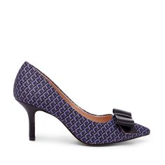 Classic pointed toe mid heel is finished with a lovely bow.