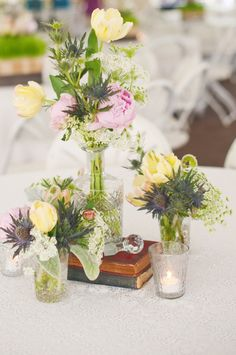 simple elegant centerpieces.  add tandem bike image.  instead of books, maybe...???