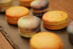 Handpainted Saffron-Orange Blossom macarons on Orange-Pistachio shells and Moroccan Spiced Coffee macarons on slate plate. Pistachio Shells, Spiced Coffee, Orange Blossom, Scotch, Macarons, Slate, Moroccan, Cheesecake, Spices