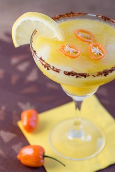 It's mango and habanero madness with this spicy margarita recipe, made with tequila, triple sec, pureed mango and fruity habanero peppers. Tequila Drinks, Cocktails, Fun Drinks, Yummy Drinks, Yummy Food, Spicy Drinks, Alcoholic Drinks, Mixed Drinks, Cocktail Drinks