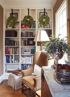 These bookshelves and comfy chair create a peaceful space for reading.