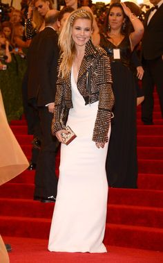 Sienna Miller broke out a Burberry studded biker jacket in honor of the #MetGala's punk theme.