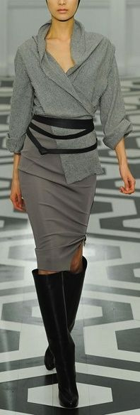 Victoria Beckham. Grey and boots.