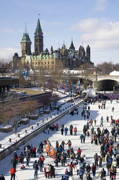 Winter skating on the Rideau with Canada's Parliament Buildings in the background ~ Ottawa, Ontario