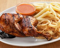 Try our famous ribs or one of the many items off our sizzling grill menu. Served with Spur-style crispy onion rings and chips OR a baked potato. Ranch Chicken, Chicken Wings, Crispy Onions, Ribs, Baked Potato, Grilling, Pork, Menu, Salad