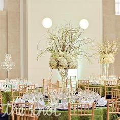 I love tall center pieces that are thin at the bottom enabling cross table conversation!!! http://weddings.theknot.com/Real-Weddings/103828/detailview.aspx?id=103828=2=3