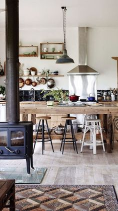 pots hanging, simple exposed island, no cabinets