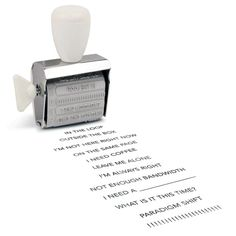"""Fancy - Office Speak Rotating Stamp Put the right words right where you need them: on a convenient rotating stamp!  With twelve eminently inkable phrases (plus black ink pad), this handy gadget does the talking (and back-talking) for you.  You're sure to be a pro at being professional in no time, even if your """"desk"""" is at the library or coffee shop. Includes a hint of wit and a ton of functionality"""