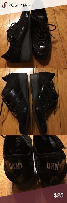 DKNY wedge casual sneaker shoes! Black fishnet & Patton letter wedge sneakers. They can be worn as a casual shoe too. Dress up or down. These are gently worn and may have a few scuffs but they are barely noticeable. Very good condition. Make me an offer. DKNY Shoes Sneakers