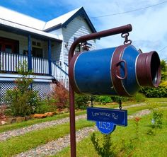 Here is a quaint Australian property sign matching the mailbox, Danthonia Designs