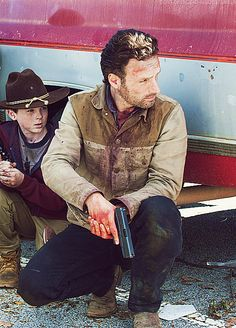 Andrew Lincoln as Rick Grimes, Carl