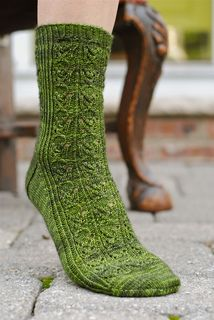 """The Brueghel sock is a cuff down sock, adorned with twisted stitches and lace. The """"Harvest"""" lace pattern reminds me of spades so I named it in honor of sixteenth century Dutch painter Pieter Brueghel best known for his paintings of peasants. Knitting Socks, Hand Knitting, Knitted Hats, Knitting Patterns, Knit Socks, Lots Of Socks, Little Cotton Rabbits, Yarn Inspiration, Winter Mode"""