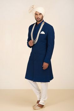 THE STYLE LOFT BY RITU DEORA Navy Blue Embroidered Shewani with Ivory Cheddar. #flyrobe #groom #groomwear #groomsherwani #sherwani #flyrobe #wedding #designersherwani Blue Sherwani, Mens Sherwani, Sherwani Groom, Wedding Sherwani, Indian Groom Wear, Indian Suits, Indian Wear, Gents Kurta, Achkan