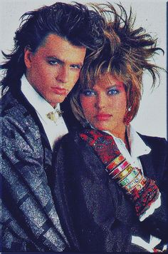 John and former girlfriend, model Renee Simonsen.  I thought she was very pretty.  I tried to do my hair like hers in this pic but I couldn't get it to stand up like that. LOL