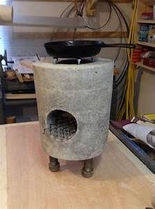 """THE """"GRILL""""-feature holds on to the burning wood fuel while simultaneously allowing the ashes to fall through and collect at the bottom (and be raked out), instead of suffocating the fire. Diy Rocket Stove, Rocket Stoves, Stove Heater, Patio Heater, Concrete Crafts, Concrete Projects, Outdoor Oven, Outdoor Cooking, Jet Stove"""