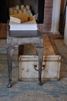 This metal table is so interesting.  It looks a bit like a queen anne sofa table.  It would be fun to try this look on wood with paint!