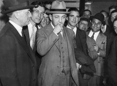 A confident Dutch Schultz, smoking, is pictured outside the N.Y. Federal Courthouse in 1935.